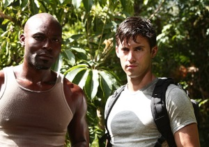 "Heroes - Season 3 - ""The Eclipse"" Part 1 - Jimmy Jean-Louis as The Haitian and Milo Ventimiglia as Peter courtesy Adam Taylor/NBC"
